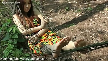Chinese Girl's Feet in Hammock