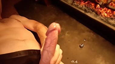 Cumshot in front of the fire