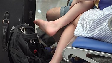 Candid, Chinese woman airing her feet and soles at the airport