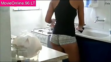 Candid sister in panties washing dishes