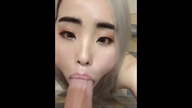 young asian girl doing what she does best sucking bwc