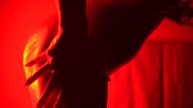 Solo nude girl in oil dancing in red light to the Weeknd music