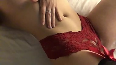 Young Brunette plays with herself in red panties