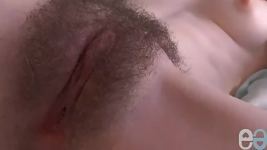 Very pretty girl has a perfect hairy pussy