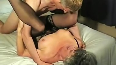 Granny enjoys two younger cocks.