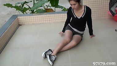Girl Wearing Canvas Shoes, Socks and Barefeet